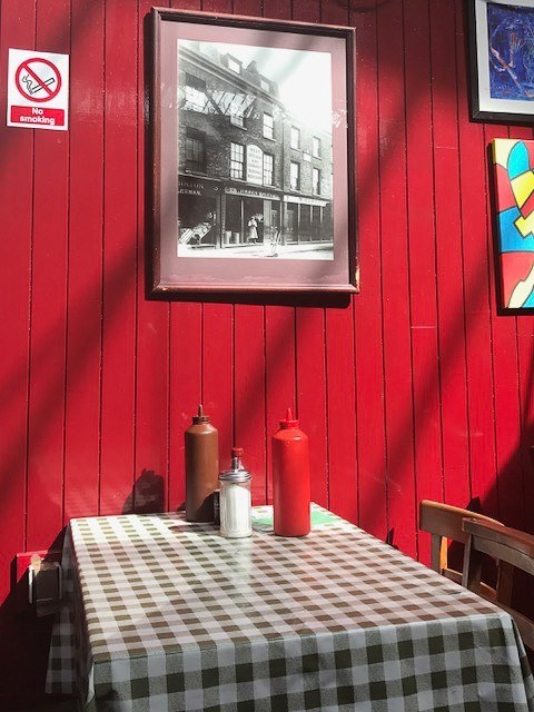 red wall and check table cloth at borough market restaurant