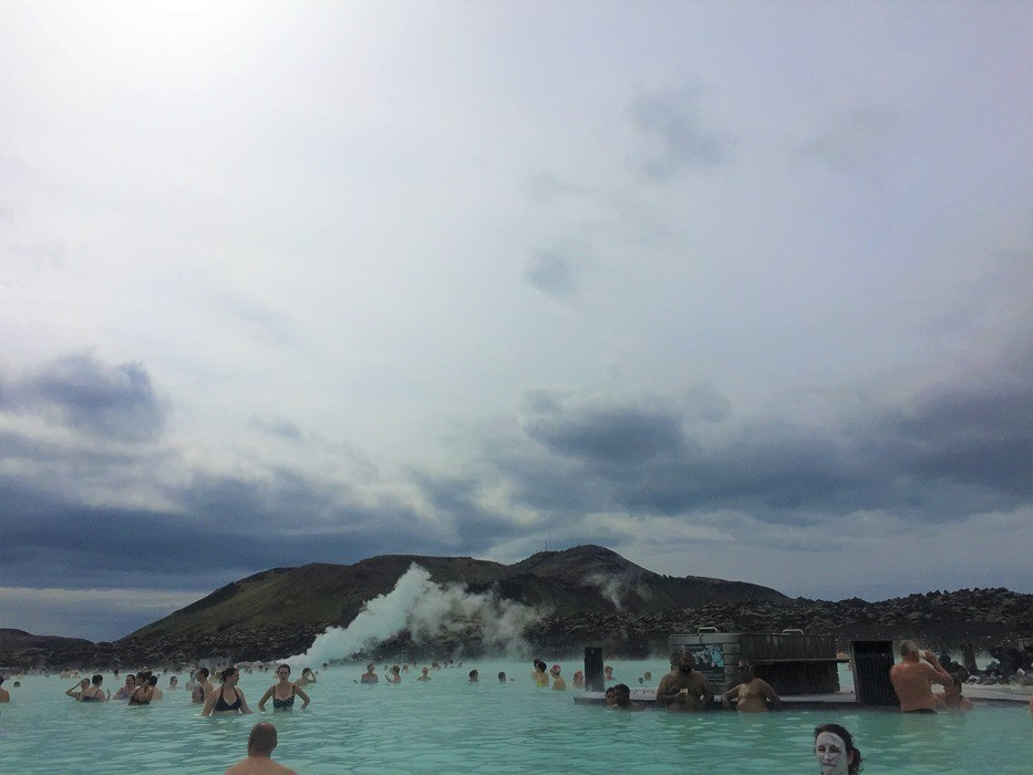 The Blue Lagoon Iceland with people in it from a distance