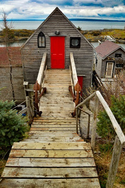 Blue Rocks Fishing Village shack with red door and walkway