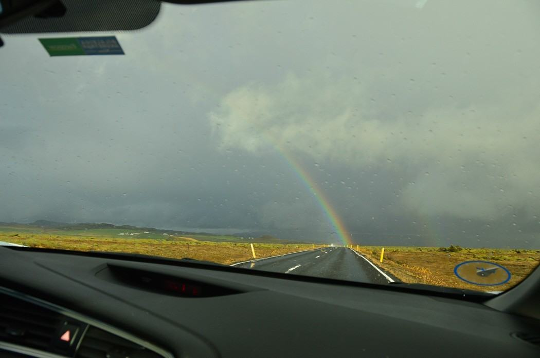 Rainbow seen from inside a car in iceland