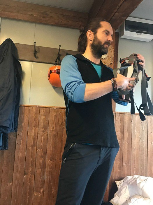 Tour Guide demonstrates harness for the volcano tour