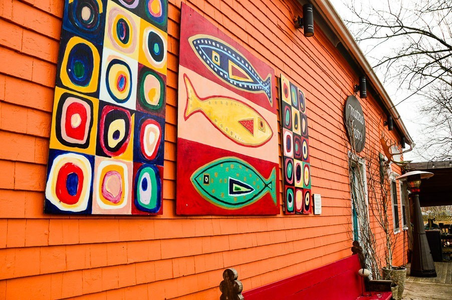 mahones bay nova scotia orange building with fish art