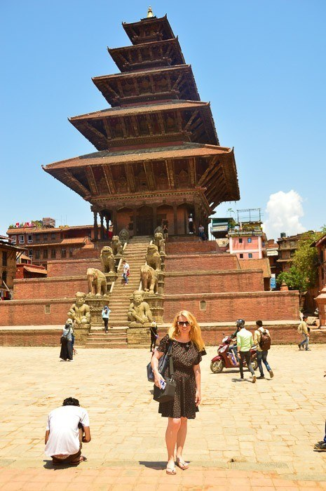 woman poses in front of a temple in bhaktapur nepal