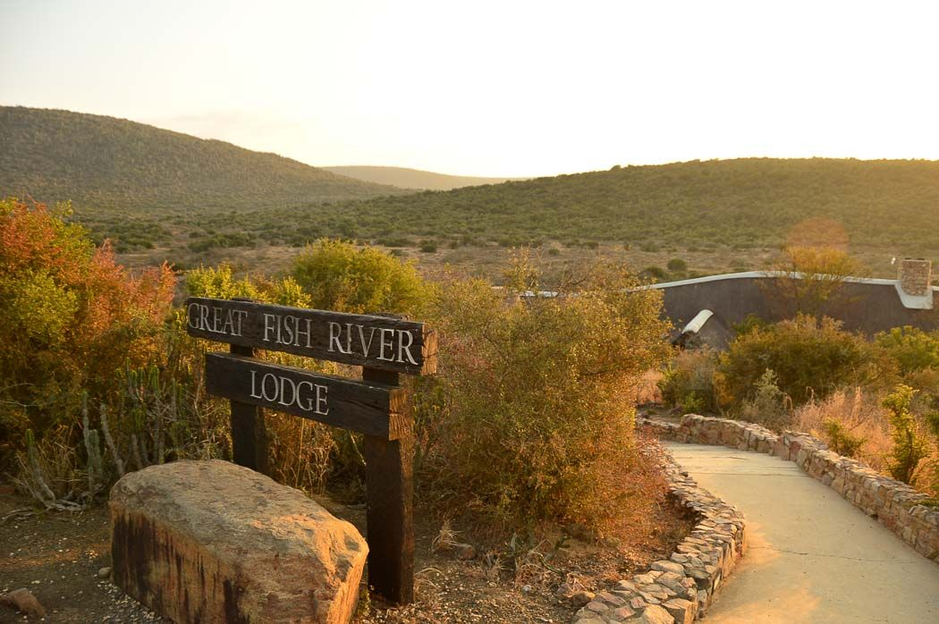 sign for great fish river lodge with african landscape behind