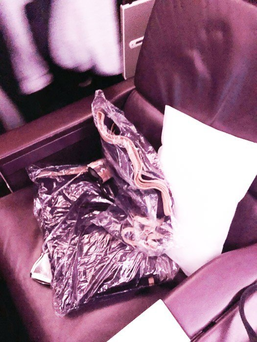 virgin atlantic premium economy seat with blanket and pillow
