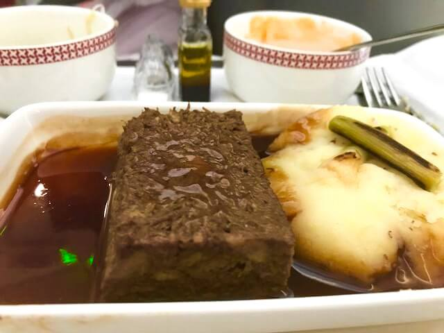 beef with gravy and mashed potato on an iberian flight business class to bogota