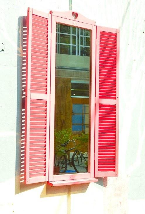 window with pink shutters in korea