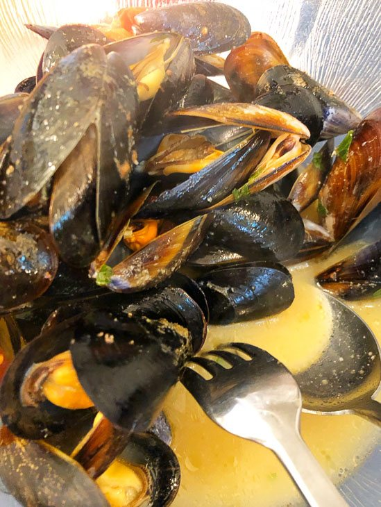 mussels on a plate with sauce in puglia