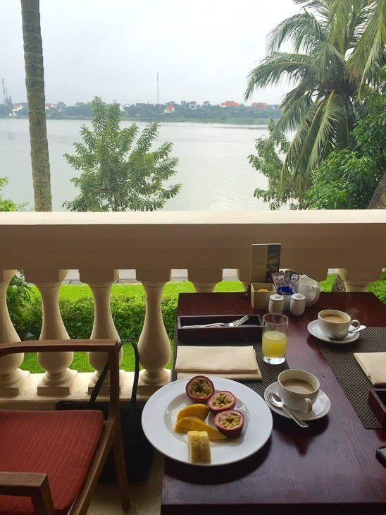 fruit and coffee on a table in front of the river Anantara hotel hoi an vietnam