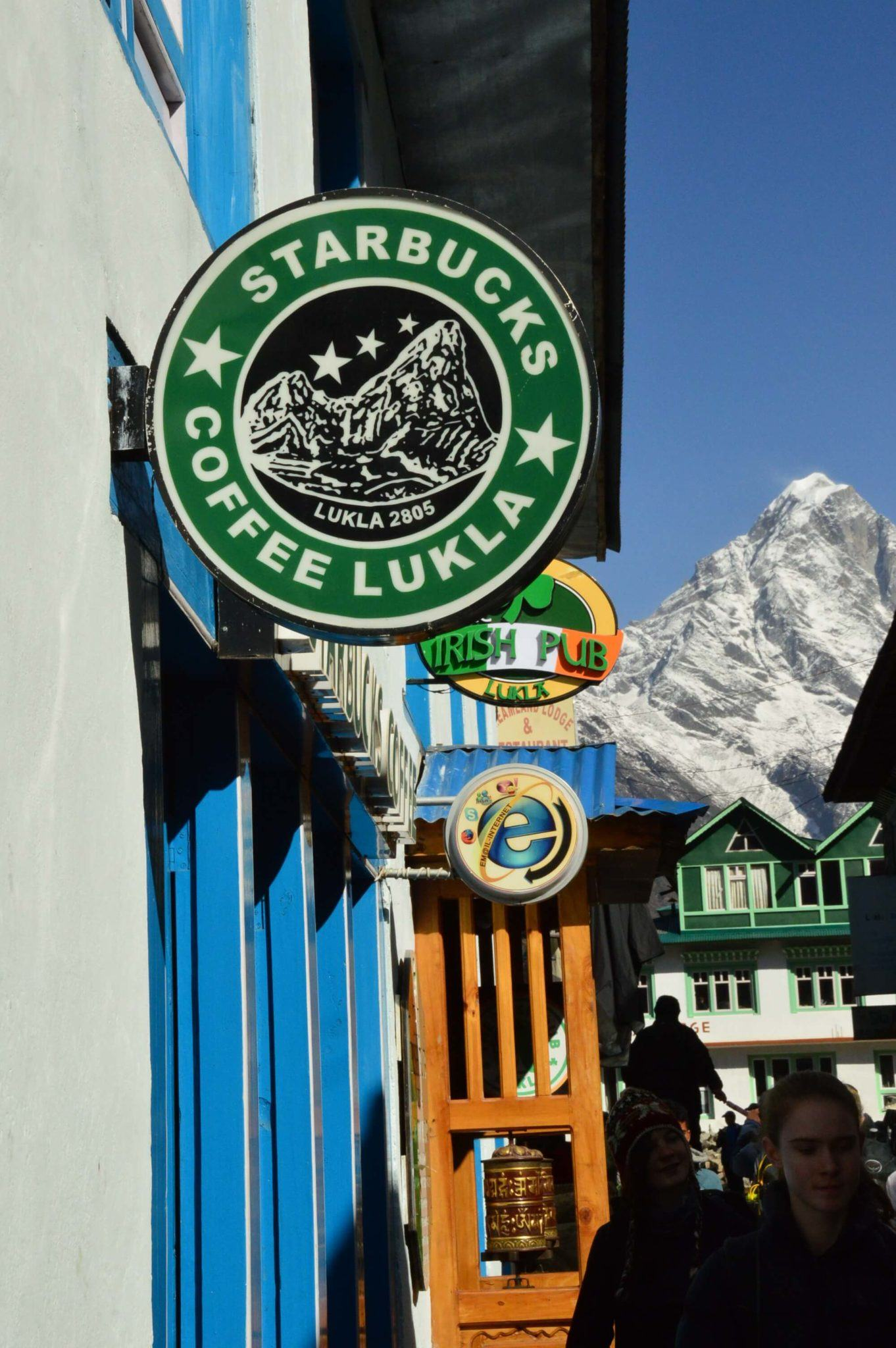 a sign for starbucks lukla on the everest base camp trek