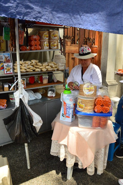 woman with street stall in Bogota