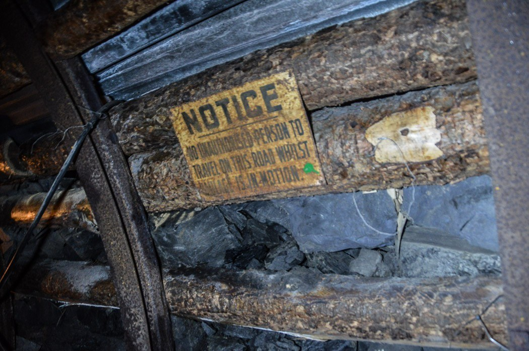 Notice sign to keep out in the mining tunnels of the welsh mining experience