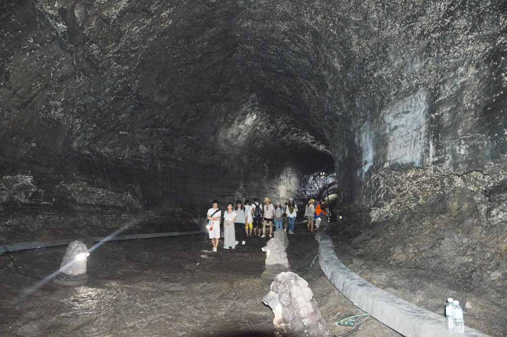 Manjanggul Cave interior with people exploring it