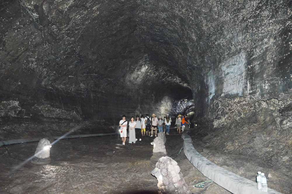 Manjanggul Cave interior with people exploring it