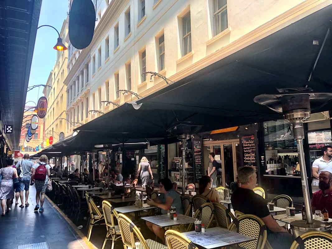 Tables and buildings in Desgraves Street <a class=