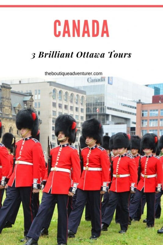 military guards in red jackets and black furry hats changing of the guard ottawa canada
