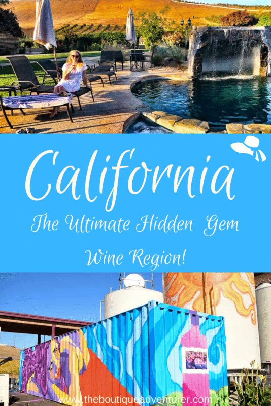 woman sitting by a pool with glass of wine and colourful wine tanks outside in Livermore California