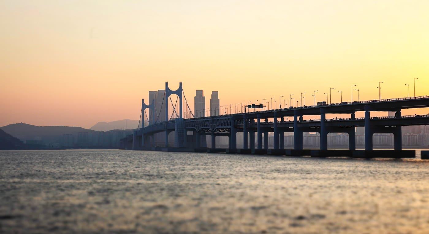 busan bridge and skyline at sunset