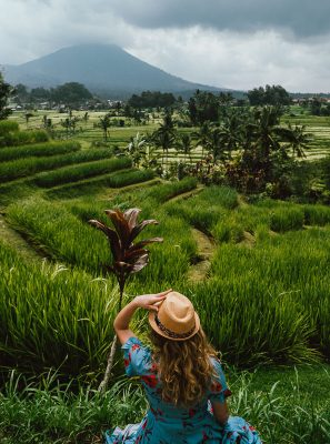 woman in hat with rice fields in bali