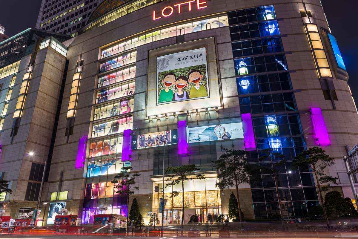 Lotte department store lit up at night in the Myeongdong district of Seoul, South Korea.