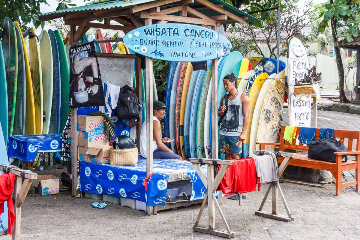 Canggu, Bali - 28th May 2017: two people talking at surfboard rental stall. The area is very popular with surfers.