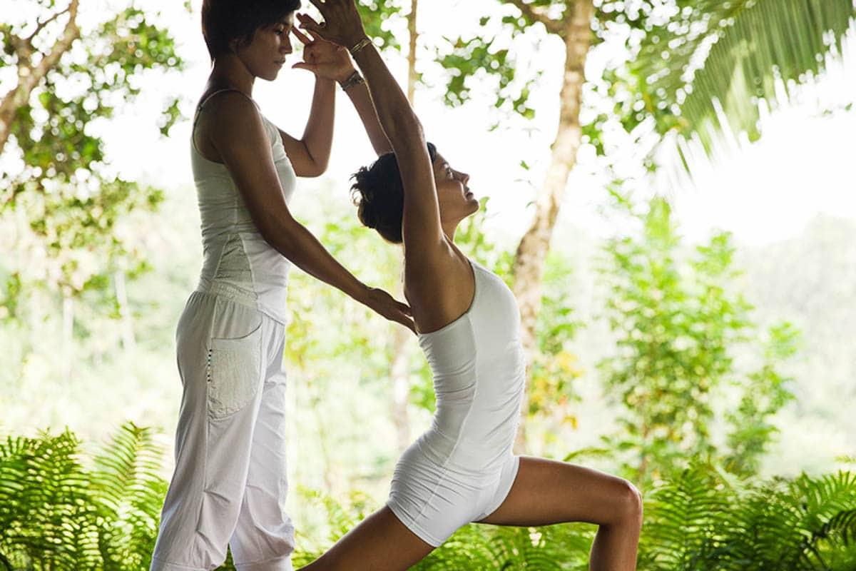 COMO Shambhala Estate bali - woman in yoga post with support