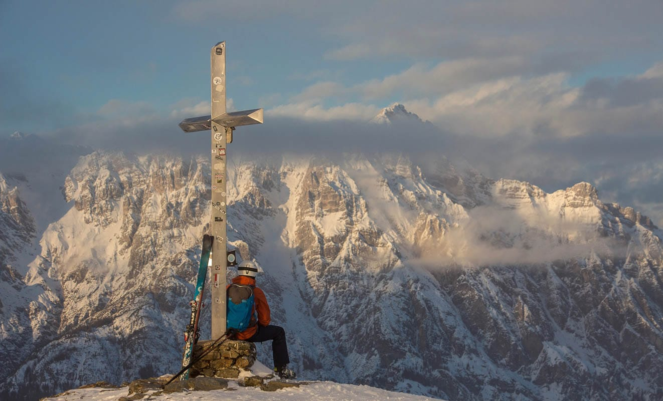 Lonely person portrait and Mountain Birnhorn Saalbach sunset summit cross