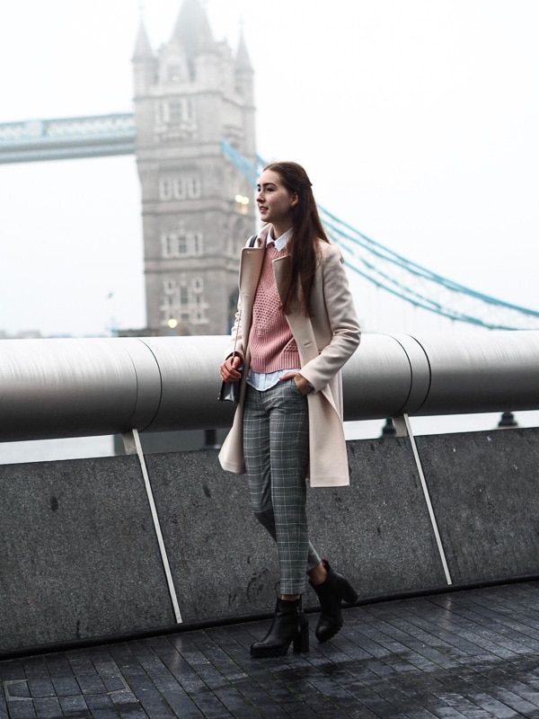 woman with tower bridge in the background