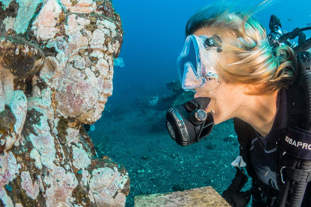 woman snorkelling with reef with face in bali indonesia
