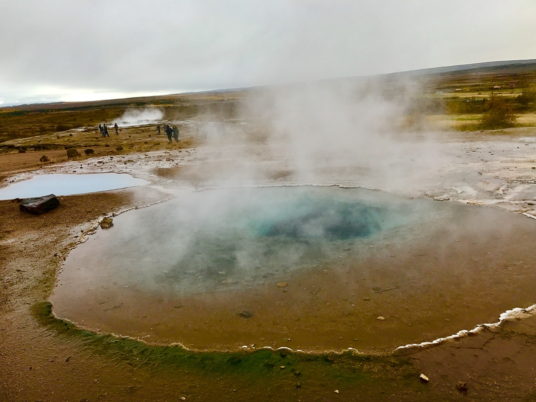 Geysir in iceland with smoke above
