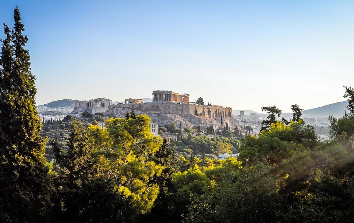 View of the acropolis with trees in foreground in athens greece