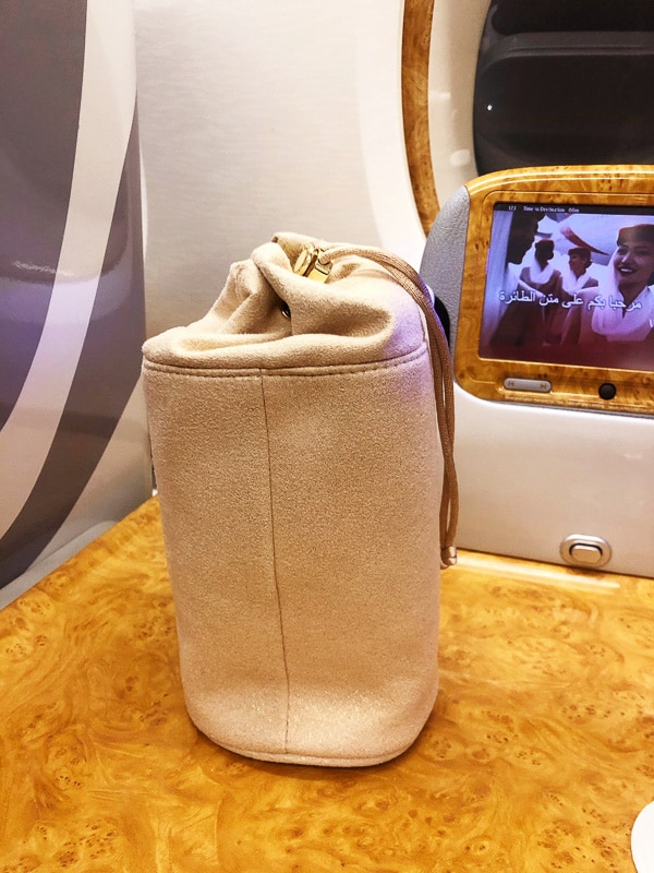 beige suede toiletries bag for emirates business class
