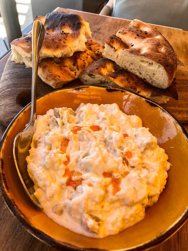 dubai la mer kaftan restaurant baba ganoush with bread
