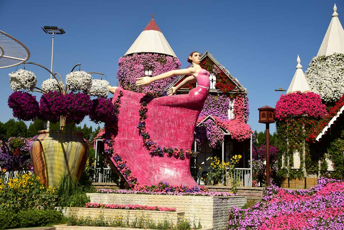 dubai miracle garden lady in pink