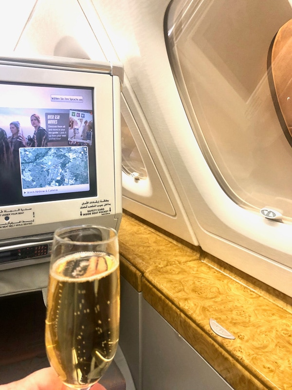 glass of champagne with emirates business class ente
