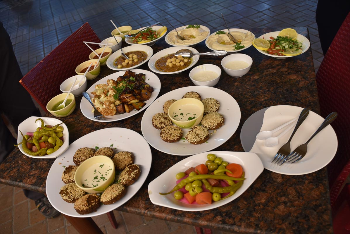 many plates of mediterranean appetisers