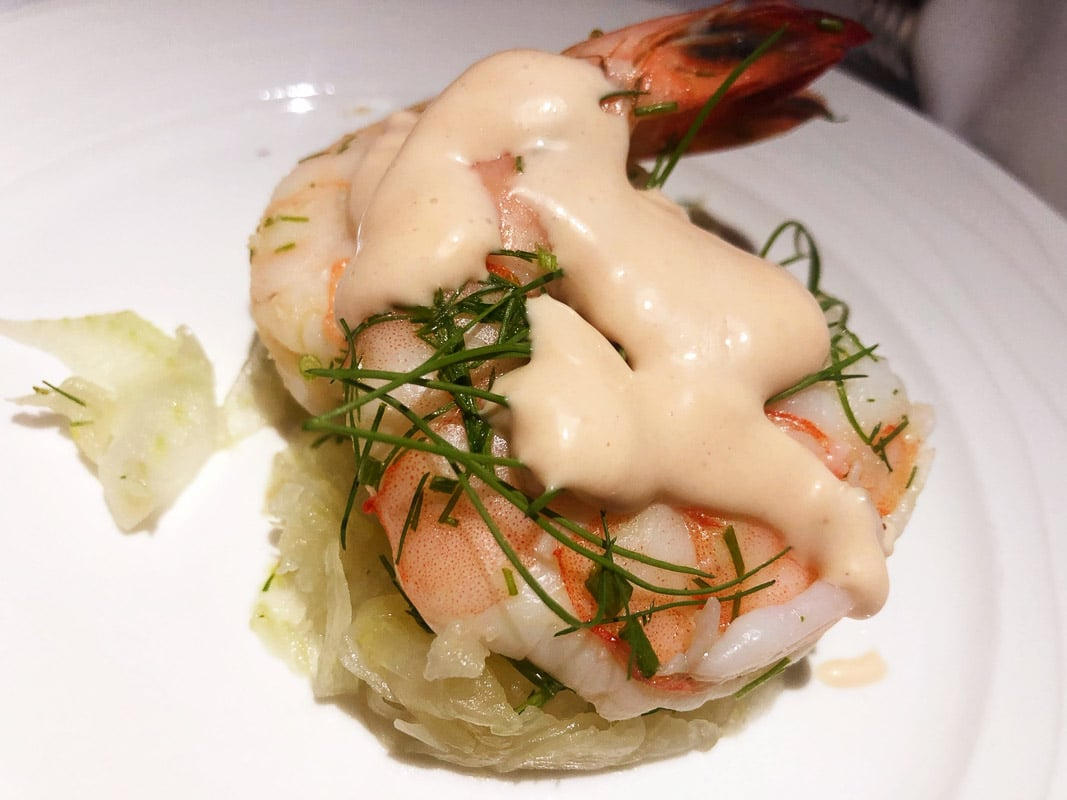 prawn with sauce salad meal on emirates business class