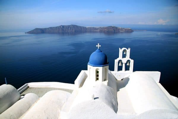 santorini-white church roof and ocean
