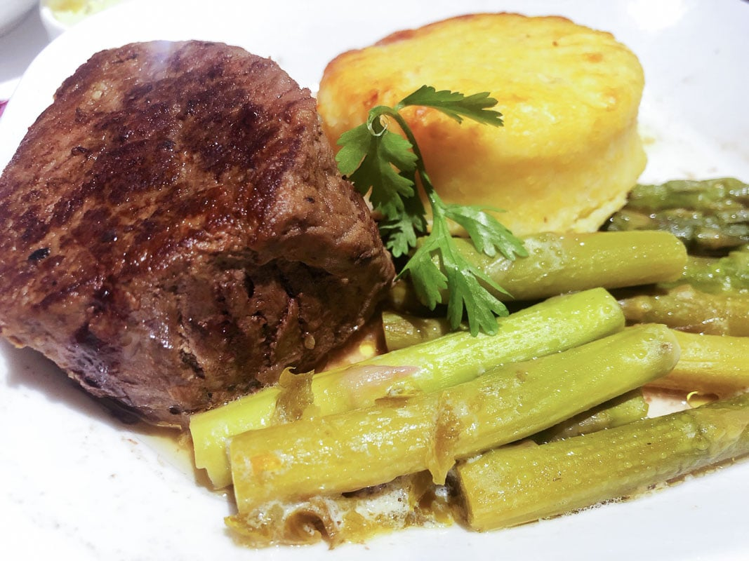 steak and vegetables on emirates business class