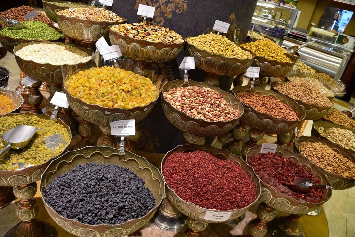 very colourful nuts and seeds in bowls for sale