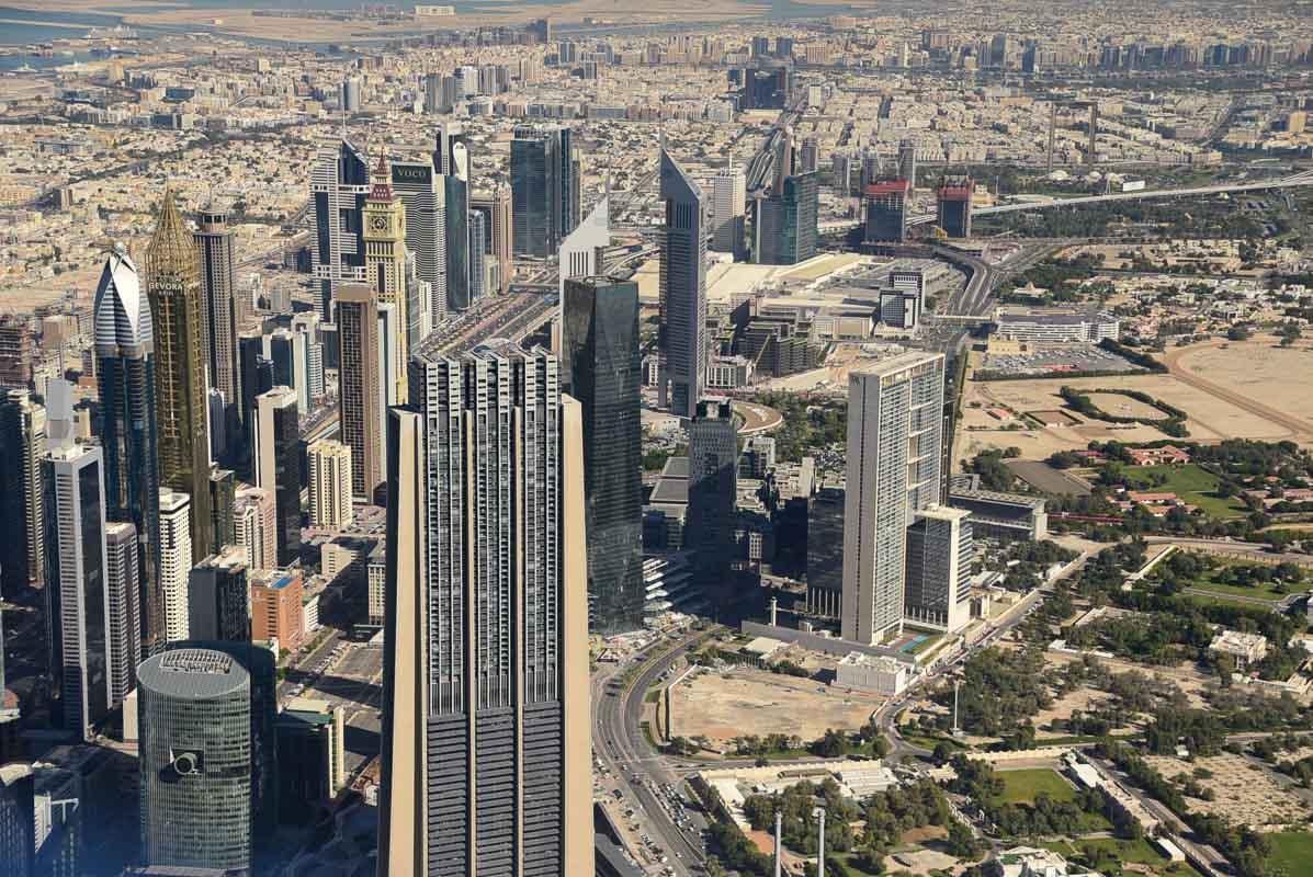 view of dubai buildings from burj khalifa