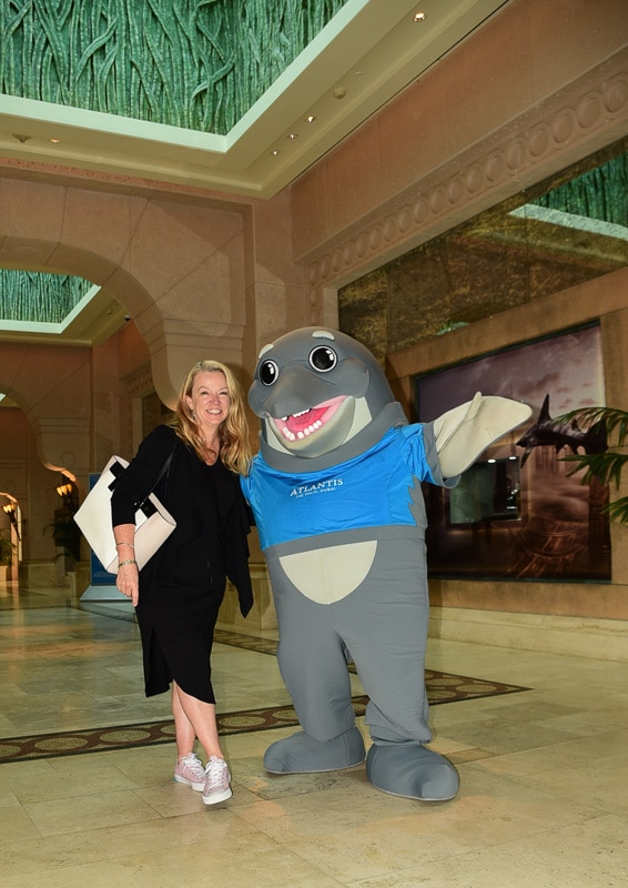 woman with person in dolphin costume at Palm Jumeirah Atlantis D