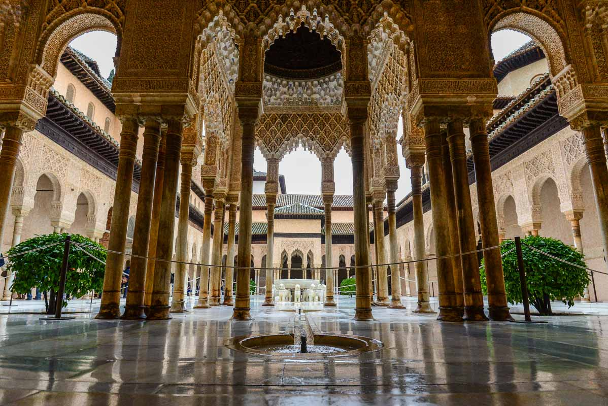 La Alhambra de Granada, a flagship of the remnants of the Islamic culture in Spain. Interiors and exteriors of delicate architectonic finesse. This is a wide angle shot of the Patio de los Leones