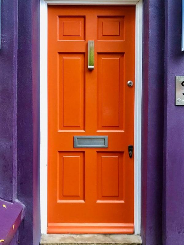 Notting Hill London orange door of purple house
