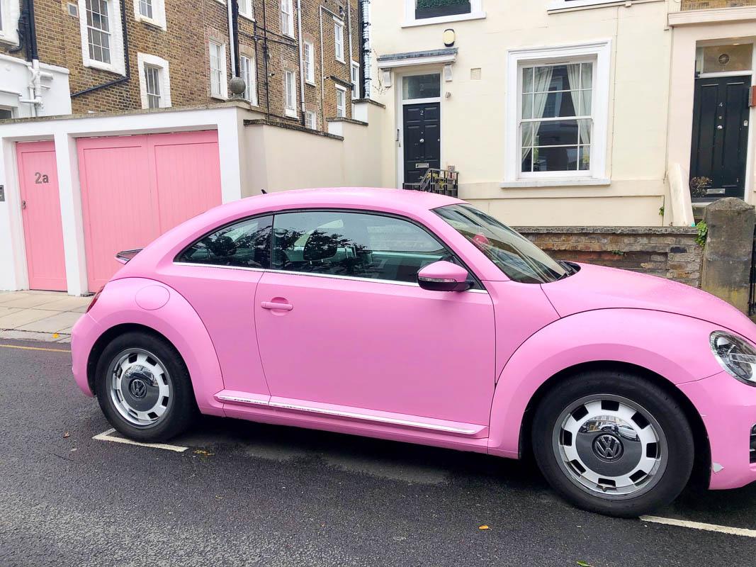 Notting Hill London pink VW bug outside pink garage
