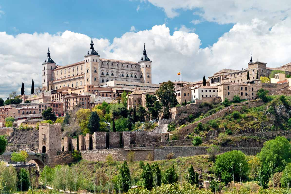 Old town of Toledo, with alcasar on a hilltop, former capital of Spain.
