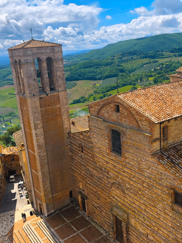 church and tower in main square of montepulciano italy