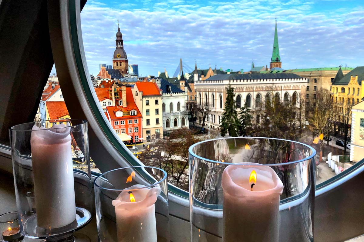 view of riga old town from window with candles