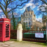 Natural History Museum London with red phone booths