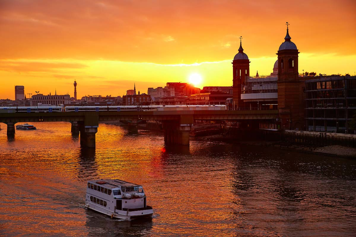 boat on the thames at sunset in london